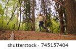 runner woman running in woods... | Shutterstock . vector #745157404