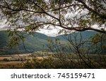 wide mountain range looking... | Shutterstock . vector #745159471