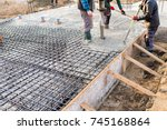 pouring concrete slab  ... | Shutterstock . vector #745168864
