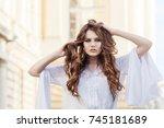 outdoor portrait of young... | Shutterstock . vector #745181689