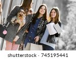 group of happy friends shopping ... | Shutterstock . vector #745195441