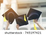 happy new graduate students... | Shutterstock . vector #745197421