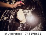 a girl prepares dough for pizza ... | Shutterstock . vector #745198681