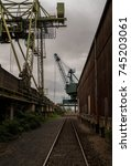 dark harbour with cranes and...   Shutterstock . vector #745203061