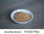 raw buckwheat in white ceramic... | Shutterstock . vector #745207981
