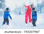 happy mother with her children... | Shutterstock . vector #745207987