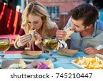 romantic couple eating street... | Shutterstock . vector #745210447