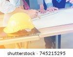closed up of engineers hands... | Shutterstock . vector #745215295