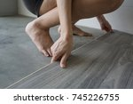 woman laying pvc floor | Shutterstock . vector #745226755