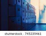 filing cabinet at sunset | Shutterstock . vector #745235461