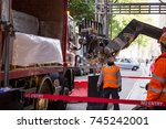 unloading a lorry's cargo with... | Shutterstock . vector #745242001