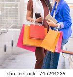 women hold shopping bag after