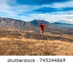 a male runner reaching the top   Shutterstock . vector #745244869