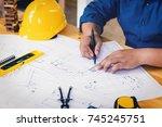 engineer man working with... | Shutterstock . vector #745245751