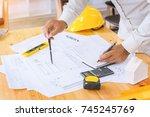 hands of engineers man hand... | Shutterstock . vector #745245769