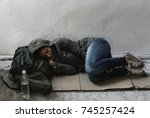 Small photo of Homeless woman