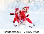 little girl and boy enjoying... | Shutterstock . vector #745277935