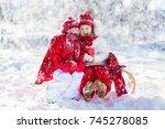 kids sledding in winter forest. ... | Shutterstock . vector #745278085