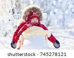 sled and snow fun for kids.... | Shutterstock . vector #745278121