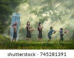 rice farmers on rice field...   Shutterstock . vector #745281391