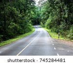 mountain road with very lush... | Shutterstock . vector #745284481