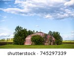 Front View Of An Abandoned And...