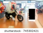 man use mobile phone  blur... | Shutterstock . vector #745302421