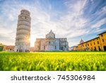 Pisa Cathedral and the Leaning Tower in a sunny day in Pisa, Italy. - stock photo