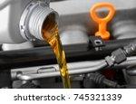 new motor oil  car engine close ...   Shutterstock . vector #745321339