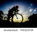 silhouette bike on sunset and... | Shutterstock . vector #745323739