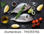 fresh uncooked dorado or sea... | Shutterstock . vector #745353781