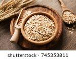 rolled oats  organic oat flakes ... | Shutterstock . vector #745353811