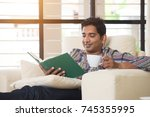 indian male having coffe and...   Shutterstock . vector #745355995