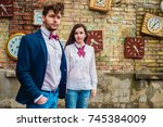 a beautifully dressed couple... | Shutterstock . vector #745384009