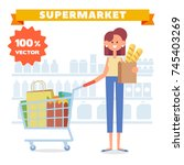 woman shopping in supermarket.... | Shutterstock .eps vector #745403269