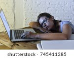 young student girl studying...   Shutterstock . vector #745411285
