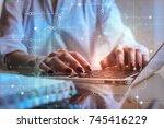 businessman hands using laptop... | Shutterstock . vector #745416229