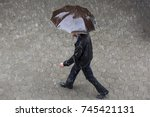 a man runs in the rainy weather ... | Shutterstock . vector #745421131