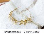 bridal golden crown on bridal... | Shutterstock . vector #745443559