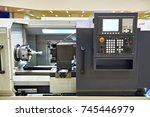 cnc lathe with cutters and... | Shutterstock . vector #745446979