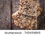 crunchy crispbread on a wooden...   Shutterstock . vector #745454845