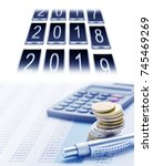 Small photo of Annual financial statements, annual financial reports, calculator and calendar