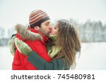 young happy kissing couple in... | Shutterstock . vector #745480981