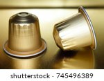 two gold aluminum capsules of... | Shutterstock . vector #745496389