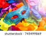 sparkly blue carnival mask sits ... | Shutterstock . vector #745499869