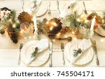 christmas table setting. | Shutterstock . vector #745504171
