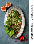 Small photo of Middle Eastern traditional salad Tabbouleh. Authentic arab cuisine. Top view, flat lay, overhead