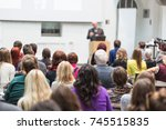 male speaker giving... | Shutterstock . vector #745515835