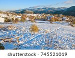 sunrise with first snow in... | Shutterstock . vector #745521019