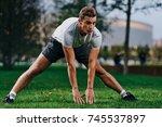 gym  exercise  sports man  park ... | Shutterstock . vector #745537897